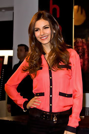 Victoria Justice was pretty in pink in a bright blouse with black trim and gold buttons.