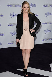 Melissa Joan Hart looked chic at the premiere of 'Justin Bieber: Never Say Never' in strappy black leather gladiator sandals.