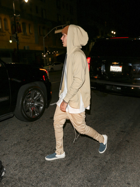 Justin Bieber puncuated his beige outfit with blue and white slip-ons by Vans.