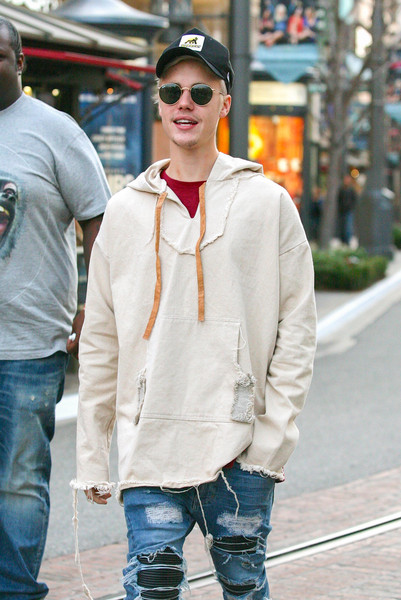Justin Bieber hid his eyes behind a pair of Ray-Ban shades while strolling through the Grove.