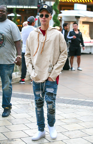 Justin Bieber completed his super-edgy attire with torn jeans by Amiri.