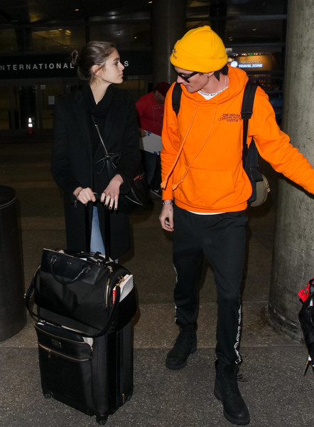 Kaia Gerber was spotted at LAX pulling along a black rollerboard.