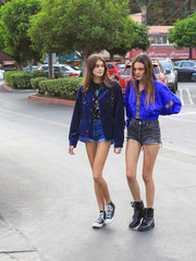 Underneath her jacket, Kaia Gerber wore jean shorts by Re/Done and a graphic tee.