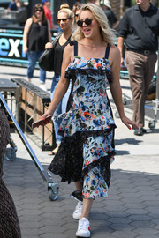Kaley Cuoco embraced summer in this tiered, mixed-print sundress by Tanya Taylor while visiting 'Extra.'