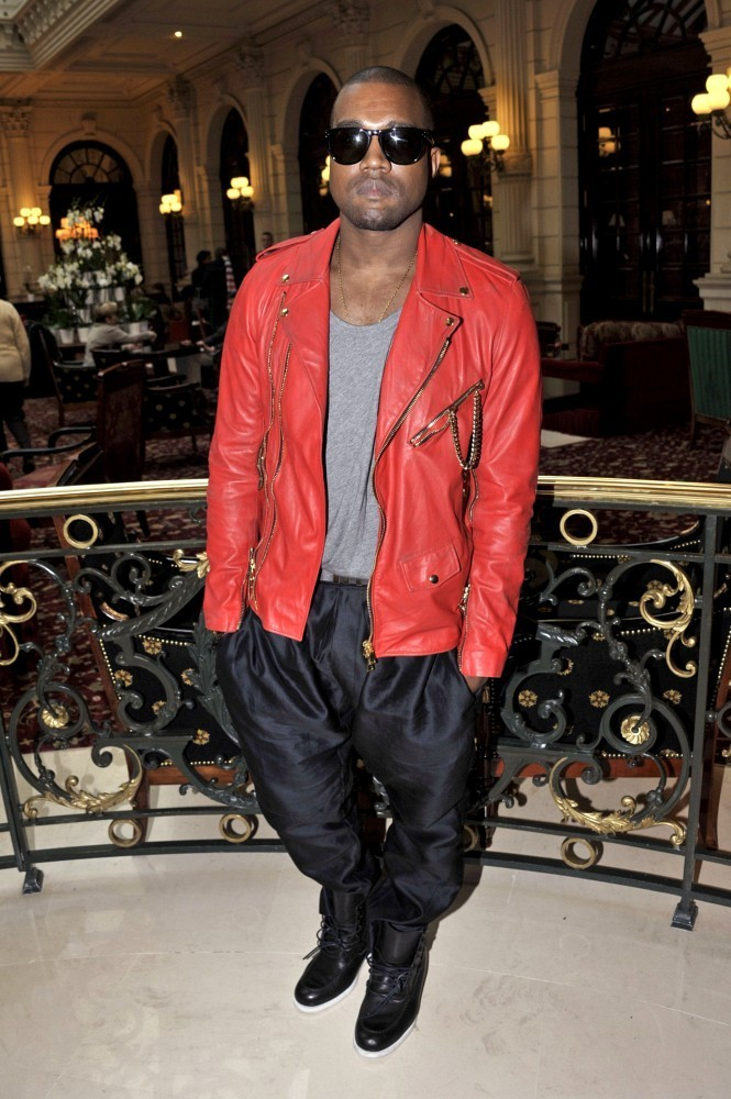 Kanye wears a vibrant leather jacket with MC Hammer pants at the Balmain fashion show