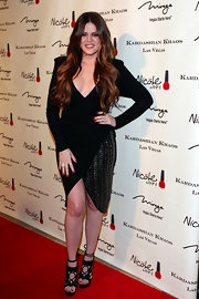 Khloe Kardashian brought excitement into her look with a pair of intricate black wrap sandals.