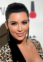Kim Kardashian wore statement black and gold earrings for the Kardashian Khaos store opening.