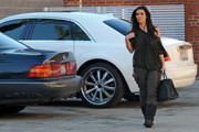 Kim Kardashian is surrounded by her film crew as she arrives at a studio for a shoot. Her mother, Kris Jenner, arrives shortly afterward.