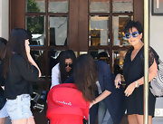 Kris sported a playful pair of oversized, periwinkle purple shades with black-out lenses.