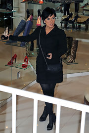 Wearing a cute little chain strap bag, Kris Jenner is spotted doing what she loves best, shopping.