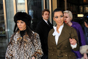 Kourtney and Kim Kardashian leave their downtown hotel and head to the Dash store in Soho.