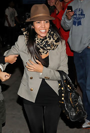 Kourtney paired her sand colored blazer with a leopard print scarf.