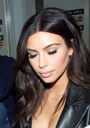 Kim Kardashian showed off an impeccably done cat eye as she arrived on a flight at Miami.