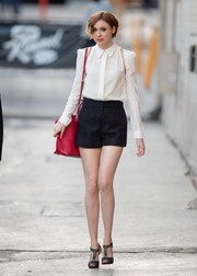 Karen Gillan styled her blouse/shorts combo with a chic pair of Christian Louboutin T-strap peep-toes.