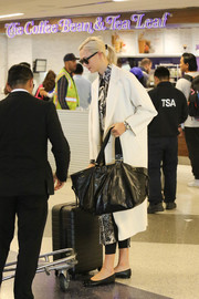 Karlie Kloss was spotted at LAX carrying a stylish oversized leather tote by Isabel Marant.