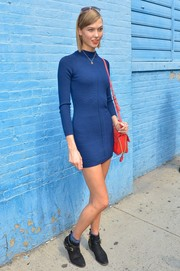 Karlie Kloss matched flat black ankle boots with a blue sweater dress for the DKNY fashion show.