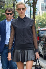 Karolina Kurkova paired an androgynous black button-down with a leather mini skirt for a stroll around New York City.