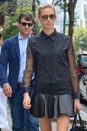 A black leather mini skirt added a girly touch to Karolina Kurkova's androgynous top.