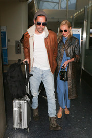 Kate Bosworth teamed a rubberized leopard-print coat by Christopher Kane with blue Tory Burch separates for a flight.