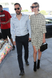 Kate Bosworth was modern-chic in a tie-waist plaid dress while catching a flight at LAX.