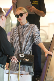 Kate Bosworth accessorized with chic round shades during a flight to LAX.