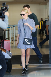 Kate Bosworth arrived on a flight at LAX looking cute in a gingham shirtdress.