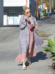 Kate Hudson completed her casual attire with a cute pair of Charlotte Olympia Kiss Me sneakers.