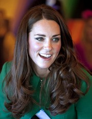 Kate Middleton wore her hair loose with curly ends while visiting Rainbow Place Children's Hospice.