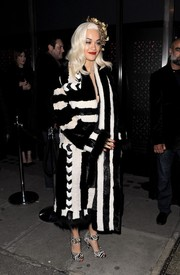 Rita Ora continued the black-and-white theme with a pair of zebra-print sandals by Tom Ford.