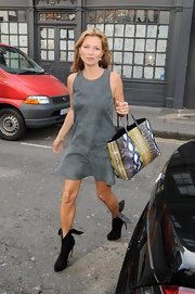 Kate Moss showed off her toned figure with this gray suede dress.