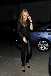Abbey Clancy attended Kate Moss' book launch party carrying a black fur clutch.
