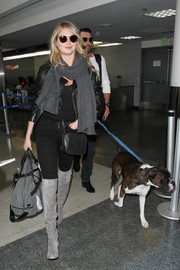 Kate Upton teamed gray suede over-the-knee boots by Sam Edelman with skinny jeans and a leather jacket for a fierce airport look.