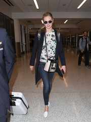 Kate Upton kept it sweet up top in a floral sweater.