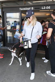 Kate Upton arrived on a flight at LAX wearing a gray Topshop 'Feminist' sweatshirt and black skinny jeans.