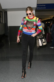 Kate Upton cut a colorful figure at LAX in a rainbow-striped sweater by Gucci.