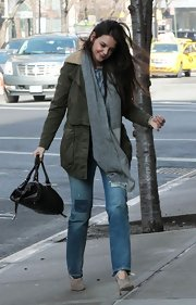 Katie Holmes was practical and stylish in this army utility jacket while out in NYC.