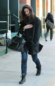 Katie Holmes battled NYC winds with this long wool coat with gold buttons.