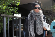Classic Katie Price!  Check out this furry black and white scarf.