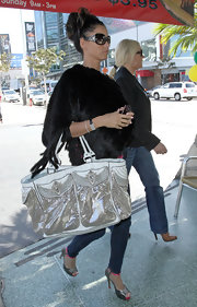 U.K. star Katie Price was seen out in LA doing a little shopping. She rocked a fur coat and a large metallic tote.