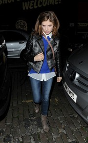 Anna Kendrick toughened up in gray lace-up boots and a moto jacket while out in London.