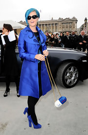 Katy Perry infused her Smurf appropriate look with whimsy, carrying the blue and white pill-shaped Pilule bag in Paris.