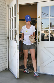 Katy sports some running shoes and spandex shorts that show off her toned legs.