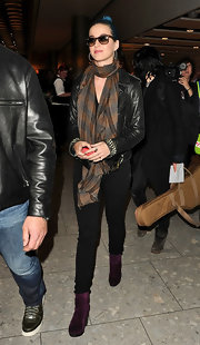 Katy Perry was wrapped up in this plaid scarf for her touch down at Heathrow.