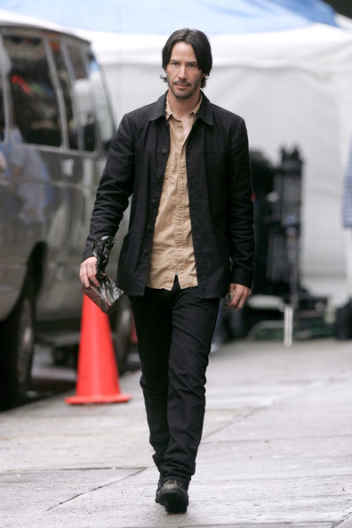 Actor Keanu Reeves was spotted wearing a black cropped jacket and un-tucked shirt.