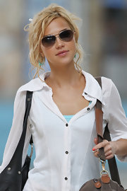 Arielle Kebbel pulled her hair up in a loose bun while arriving at the airport.