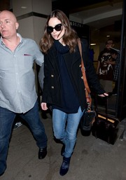 For her footwear, Keira Knightley chose a chic pair of blue velvet ankle boots.
