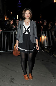 Keira wore a gray heathered blazer over her sailor dress out in London.