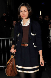 Kiera channels the 70s in a blue navy jacket with a rounded collar and lapels.