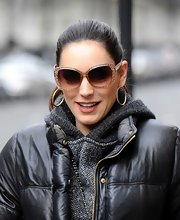Kelly Brook opted for a pair of square-shaped shades with a funky crackle design on the rims.