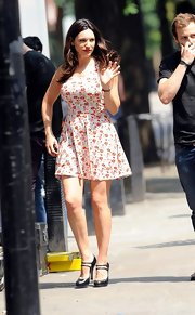 A fun printed day dress gave Kelly Brook a summery look on the set of 'Taking Stock.'